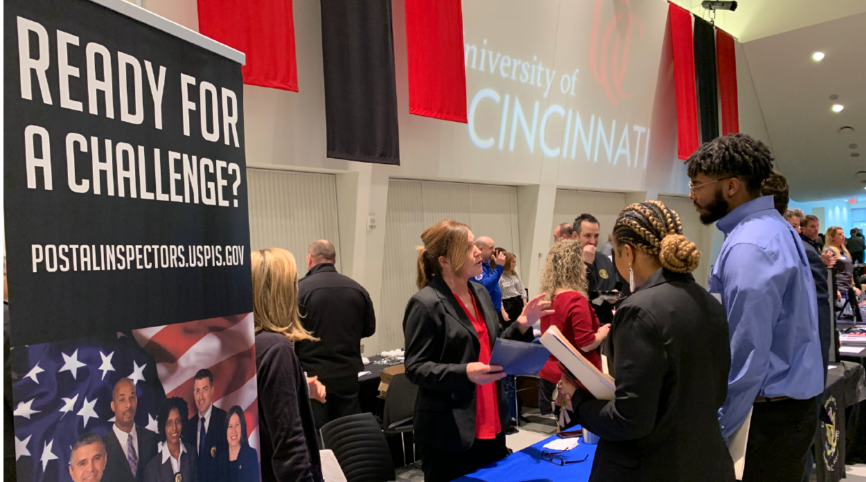 Students chatting with a recruiter during at a career fair booth