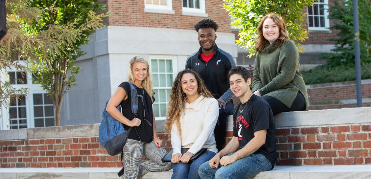 Three females and two males who are students within the School of Human Services.